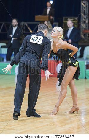 Minsk Belarus-February 19 2017: Professional Dance Couple of Borushko Serhii and Voloshanenko Yelizaveta Performs Adults Latin-American Program on WDSF Minsk Open Dance Festival-2017 on February 19 2017 in Minsk Belarus.