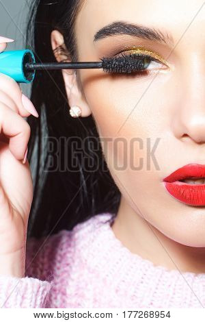 Sexy Woman With Red Lips And Long Hair Hold Mascara