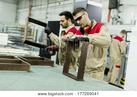 Workers In The Furniture Factory