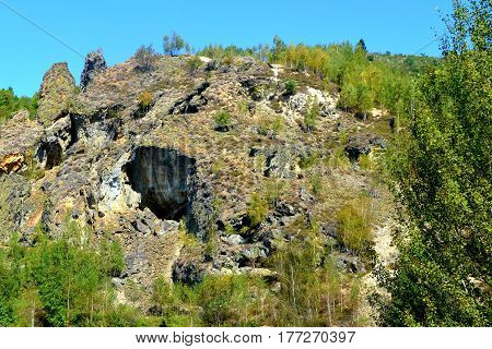 The Apuseni Mountains is a mountain range in Transylvania, Romania, which belongs to the Western Romanian Carpathians, also called Occidentali in Romanian. The Apuseni Mountains have about 400 caves