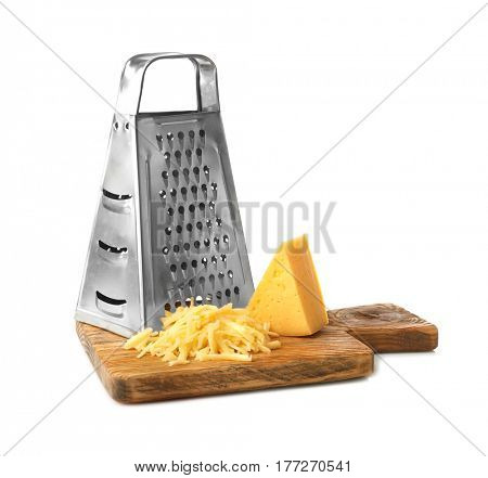 Wooden board with metal grater and cheese isolated on white