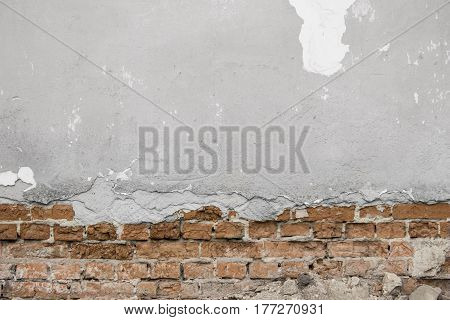 Grey Cracked Concrete Wall With Bricks