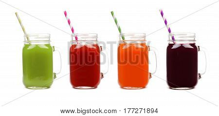 Four Mason Jar Glasses Of Vegetable Juice, Greens, Tomato, Carrot And Beet, Isolated On A White Back