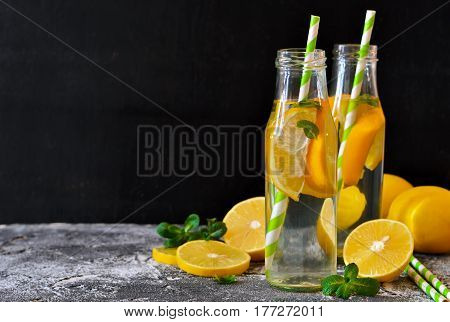 Summer drink - cold lemonade with mint on a concrete background