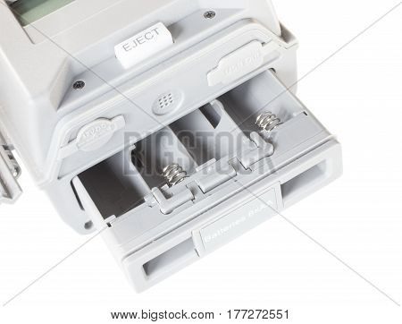 Tray that holds eight AA batteries on a security camera