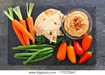 Hummus Dip With A Platter Of Fresh Vegetables, Above View On A Slate Background