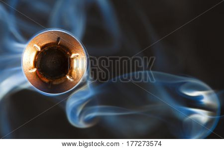Copper plated bullet and smoke coming at the camera