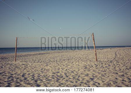 Beach Volleyball net at sunset near Black Sea