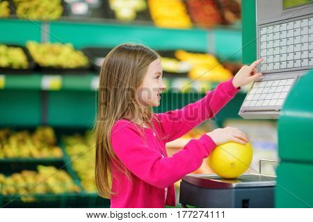 Cute Little Girl Shopping In A Food Store