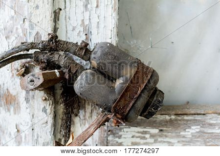 Closeup 50 years Old locked on rusty wooden the door. Focus on lock
