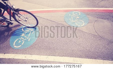 Vintage Toned Bicycle Lane With Part Of A Bike In Motion.