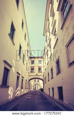 Old narrow street in Vienna color toned picture Austria.
