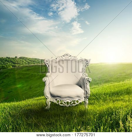 Arm chair and landscape on sunset