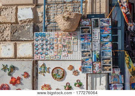 SYRACUSE ITALY - SEPTEMBER 14 2015: Traditional souvenirs of ceramics and Trinacria is symbol of Sicily Italy.