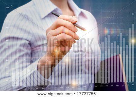 Businesswoman Analyzes The Chart .