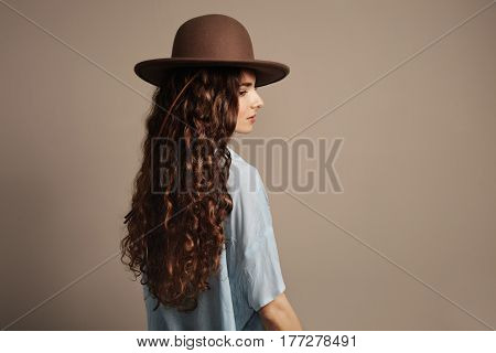 studio shoot of woman showing her ideal curly natural hair