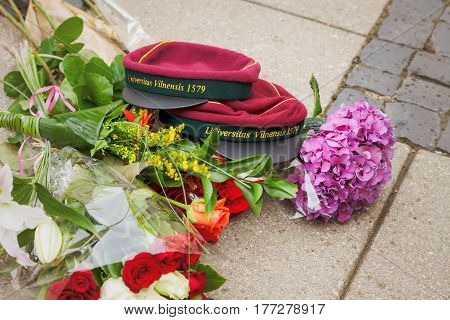 Vilnius Lithuania - June 18 2014: Head-wear with name of university in Latin and flowers are lying during student graduation ceremony of Vilnius University.