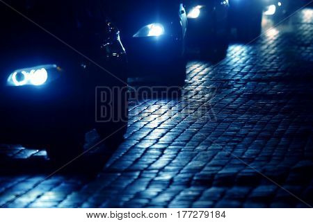 cars go at night on the pavement