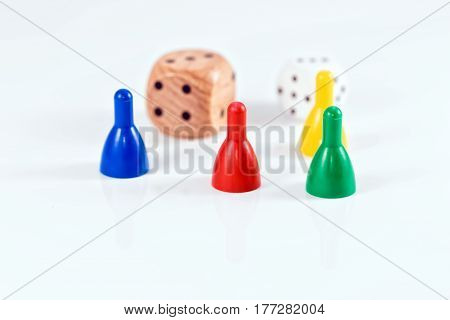 Colorful Game Pieces And Cubes Of Plastic And Wood