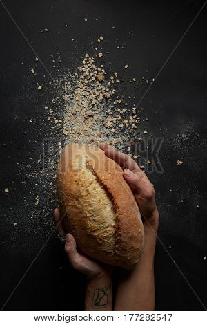 hands with a bread