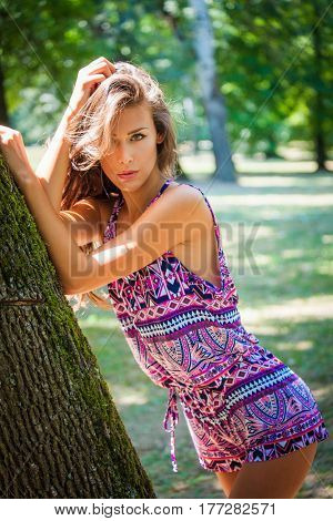 fashion city girl in short jumpsuite hot summer day outdoor in park