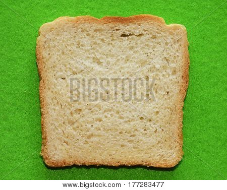 Slice of bread on the green background