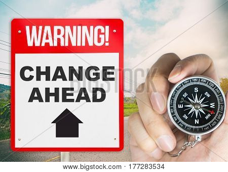 Change Ahead signage with compass for Direction
