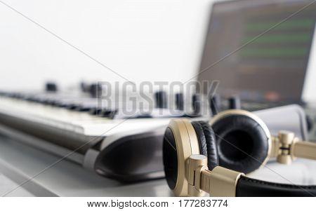 Golden Music Studio headphone with Computer music producing equipment.