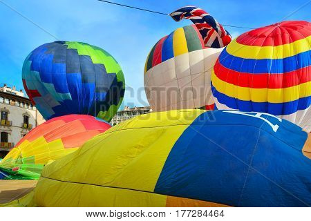 Colorful hot air balloons in the main square of the historic Spanish city of Vic. Spain, province Barcelona