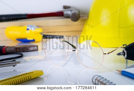 Engineer construction repair tools with eyeglass in the middle
