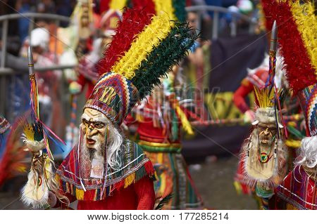 ORURO, BOLIVIA - FEBRUARY 25, 2017: Tobas dancers in colourful costumes performing at the annual Oruro Carnival. The event is designated by UNESCO as being Intangible Cultural Heritage of Humanity.
