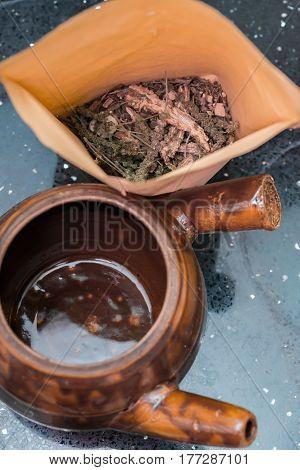 top view herbal near to an enamel pot