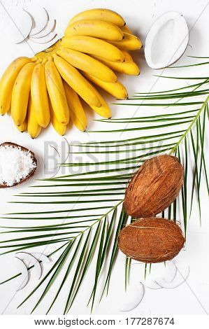 Bunch Of Bananas, Coconuts And Palm Leaf