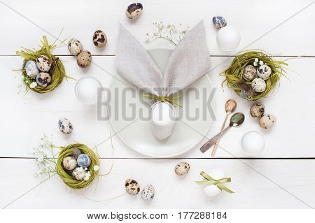 Easter Table Decoration With Napkin In The Form Of Rabbit Ears, Eggs And Nests