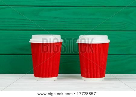 two red paper cardboard coffee Cup texture green
