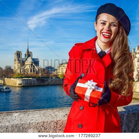 Smiling Woman In Paris, France With Christmas Present Box