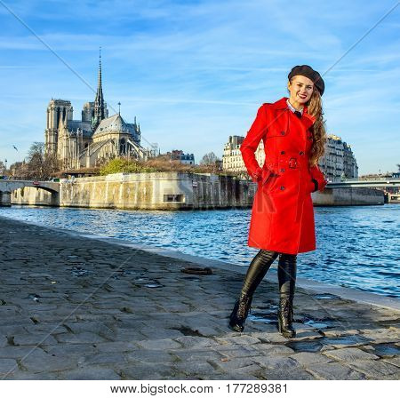 Traveller Woman Standing On Embankment Near Notre Dame De Paris