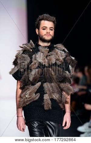MOSCOW RUSSIA - MARCH 14 2017: Model walk runway for YULIA KOSYAK catwalk at Fall-Winter 2017-2018 at Mercedes-Benz Fashion Week Russia.