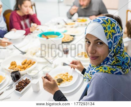 Muslim family eating iftar in Ramadan at home together
