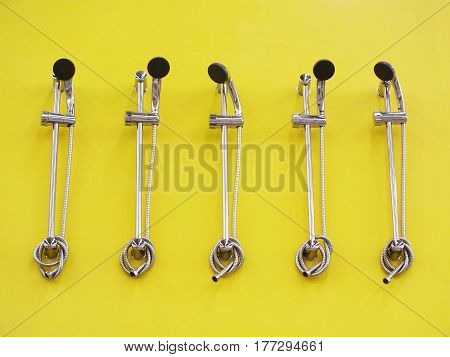 Shower head isolated on yellow background, 5 objects