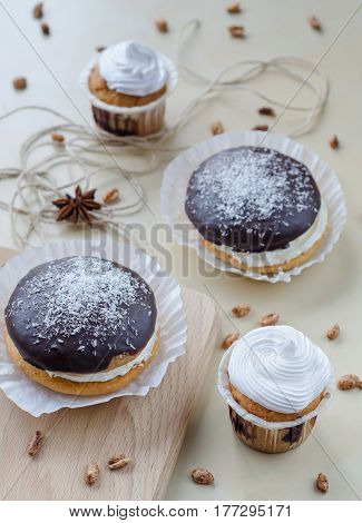 Cakes With Chocolate And Coconuts Decorated With Dried Cloves And Twine.