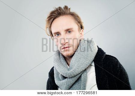 Young Man with Fashion light Hairstyle Posing