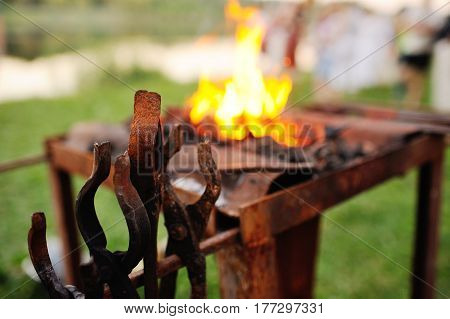 Blacksmith tools on the background of close-up fire