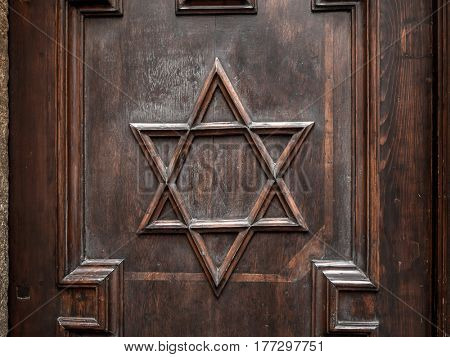 Symbol of Star of David on old synagogue wooden door