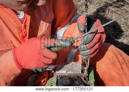 Close-up Professional Chainsaw Blade,sharp Chain Rasp.the Chain On The Saw For Cutting Wood