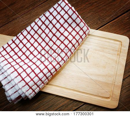 Kitchen Towels And Cutting Board On A Table