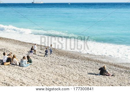Nice, France - 25 February, A group of people on the Cote d'Azur, 25 February, 2017. People and tourists having a rest on the Cote d'Azur.