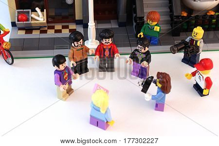 Colorado, USA - March 20, 2017: Studio shot of Lego minifigure Beatles standing together on a street in front of a building surrounded by fans.