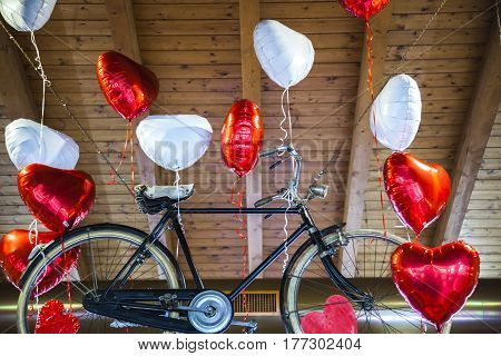 Flying Old Bike Bound To Heart Shaped Balloons