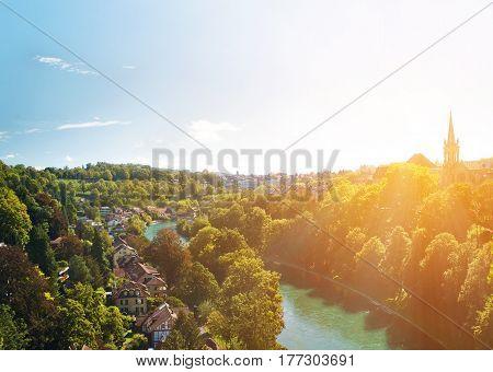Swiss capital Bern buried in verdure at sunset